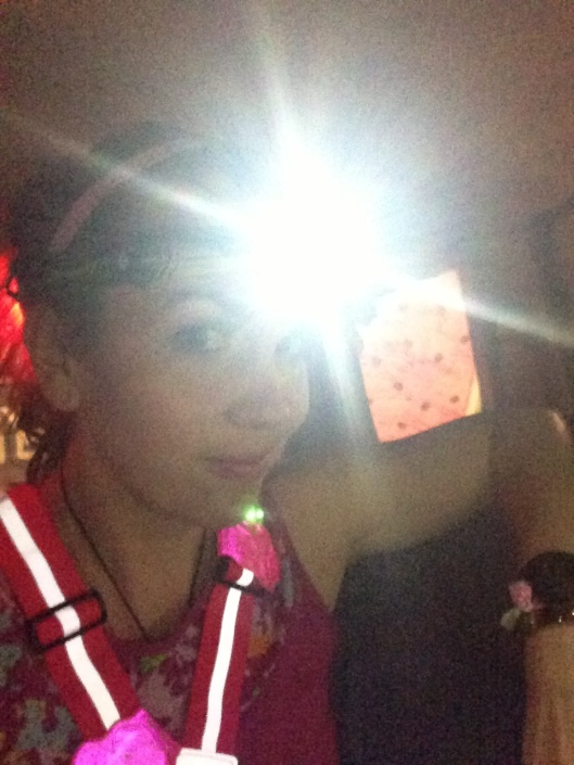 Lit up for my night run. How cute is the pink Amphipod flower and vest?!?