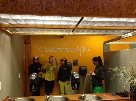 """You are Beautiful"" painted backwards on wall so the mirror reflection tells you how it is."